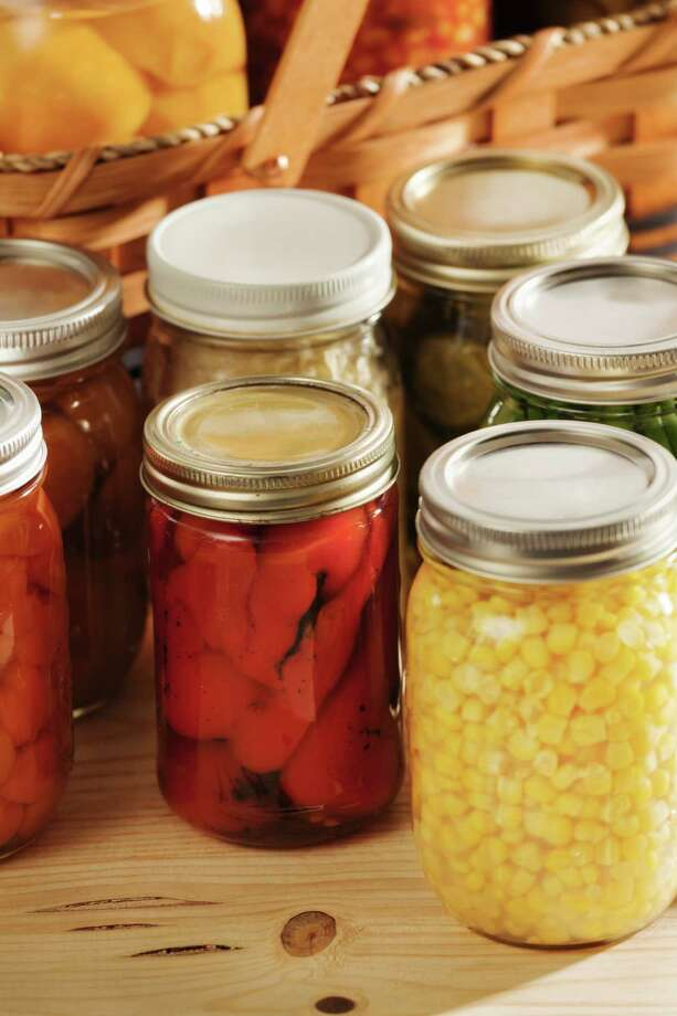Home canning is a way to preserve harvested vegetables.