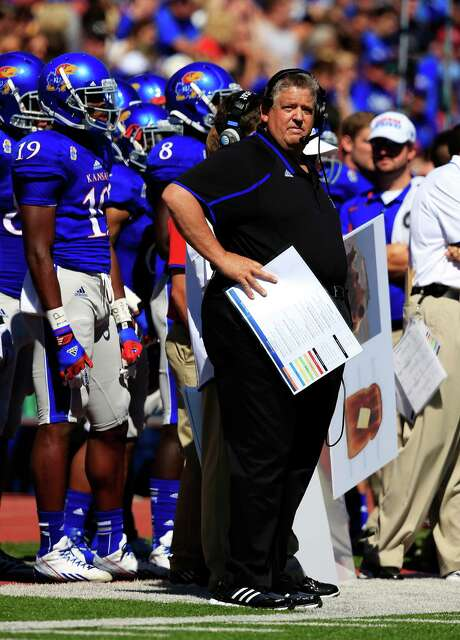 """Charlie Weis guided Kansas to a 13-10 victory over Louisiana Tech. The Jayhawks (2-1) snapped a 22-game losing skid to FBS teams. """"I'm kind of counting on us being able to look back to this game and saying, 'That was the game when they turned the corner,'"""" Weis said. Photo: Jamie Squire / Getty Images"""