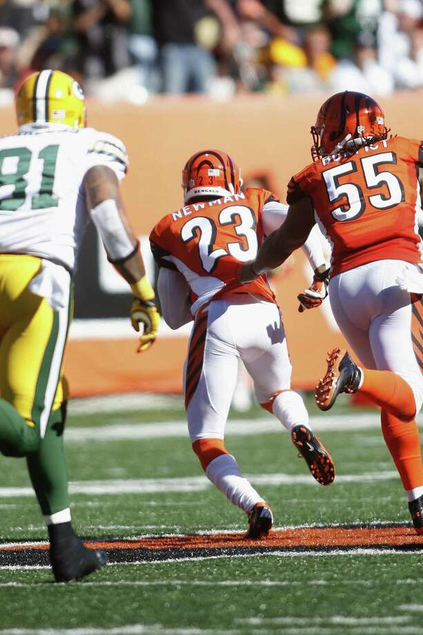 Ex-Cowboy Terence Newman returns a fumble for a touchdown, delivering the final blow in a game full them as the Bengals edged the Packers on Sunday. Photo: John Grieshop / Getty Images