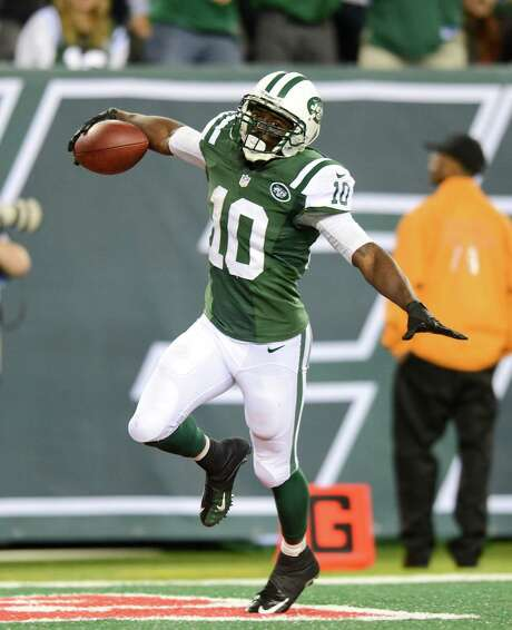Santonio Holmes helped the Jets rise above a franchise-worst 20 penalties for a 27-20 victory over the Bills. Photo: Ron Antonelli / Getty Images