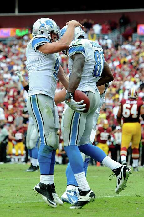 QB Matthew Stafford (left) and receiver Calvin Johnson helped the Lions end an 0-for-21 drought in Washington. Photo: Patrick McDermott / Getty Images