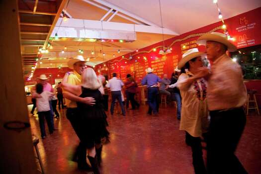 Though the image of Texas as the Wild West is slowly fading, steaks — and country music played in dance halls for couples who know their way around a dance floor — show no sign of waning. Little Red Barn Steakhouse has been a fixture on the Southeast Side since 1963. — Jim Beal Jr. Photo: For The Express-News