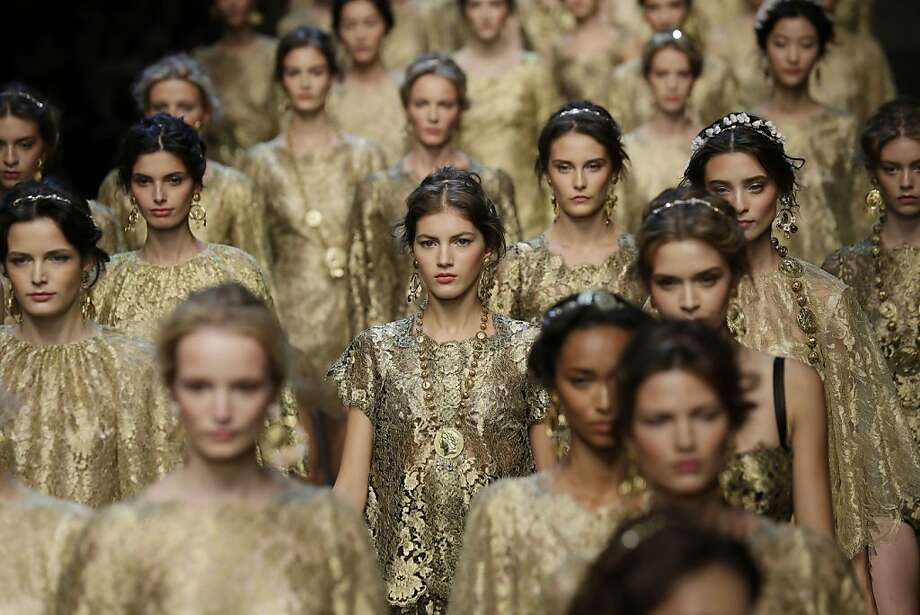 Models wear creations for Dolce & Gabbana women's Spring-Summer 2014 collection, part of the Milan Fashion Week, unveiled in Milan, Italy, Sunday, Sept. 22, 2013. (AP Photo/Luca Bruno) Photo: Luca Bruno, Associated Press