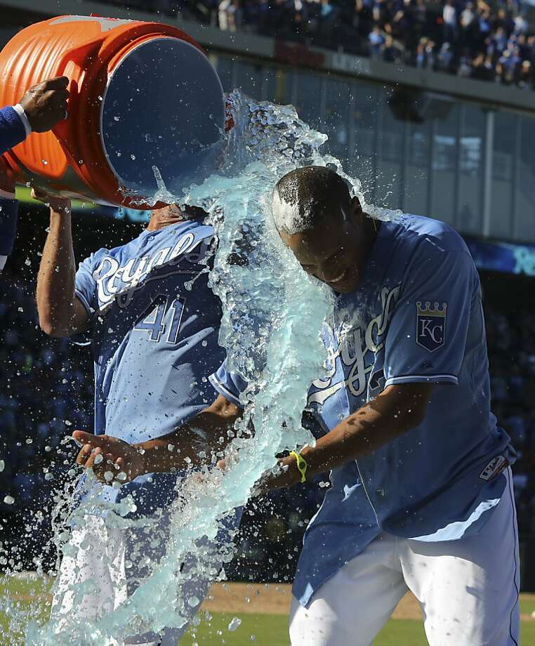 KANSAS CITY, MO - SEPTEMBER 22:  Justin Maxwell #27 of the Kansas City Royals is doused with water by Danny Duffy #41 after hitting a walk-off grand slam in the 10th inning against the Texas Rangers at Kauffman Stadium on September 22, 2013 in Kansas City, Missouri. (Photo by Ed Zurga/Getty Images) Photo: Ed Zurga, Getty Images