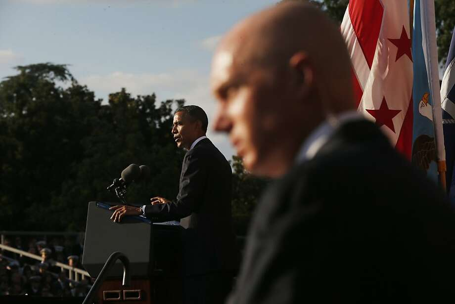 A U.S. Secret Service agent stands watch as President Barack Obama speaks at a memorial service for the victims of the Washington Navy Yard shooting at Marine Barracks Washington Sunday, Sept. 22, 2013.  A gunman killed 12 people in the Navy Yard on Monday, Sept. 16, 2013, before being fatally shot in a gun battle with law enforcement. The president and first lady Michelle Obama also visited with the victims' families. (AP Photo/Charles Dharapak) Photo: Charles Dharapak, Associated Press