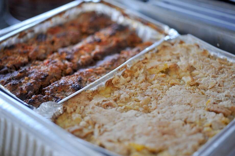 Oven roasted chicken with cheese at the Yellow Bird Farm food truck on Wednesday. The traveling treats and homemade meals can be spotted in front of D'Vine Wine on Calder. Photo taken Wednesday, September 11, 2013 Guiseppe Barranco/The Enterprise Photo: Guiseppe Barranco/The Enterprise