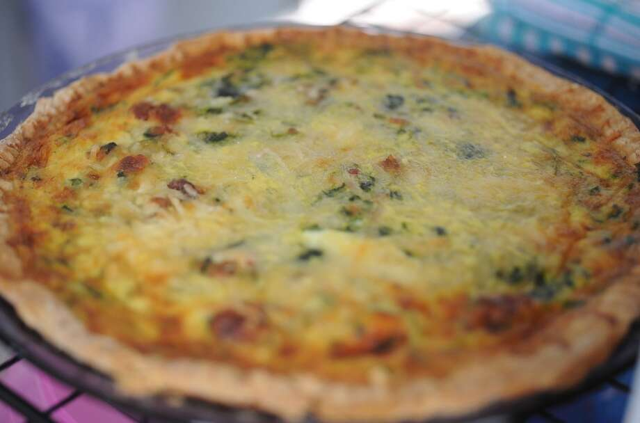 Quiche with spinach, bacon and cheese at the Yellow Bird Farm food truck on Wednesday. The traveling treats and homemade meals can be spotted in front of D'Vine Wine on Calder. Photo taken Wednesday, September 11, 2013 Guiseppe Barranco/The Enterprise Photo: Guiseppe Barranco/The Enterprise
