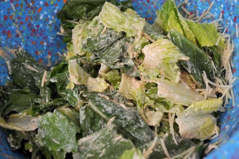 Caesar salad at the Yellow Bird Farm food truck on Wednesday. The traveling treats and homemade meals can be spotted in front of D'Vine Wine on Calder. Photo taken Wednesday, September 11, 2013 Guiseppe Barranco/The Enterprise Photo: Guiseppe Barranco/The Enterprise