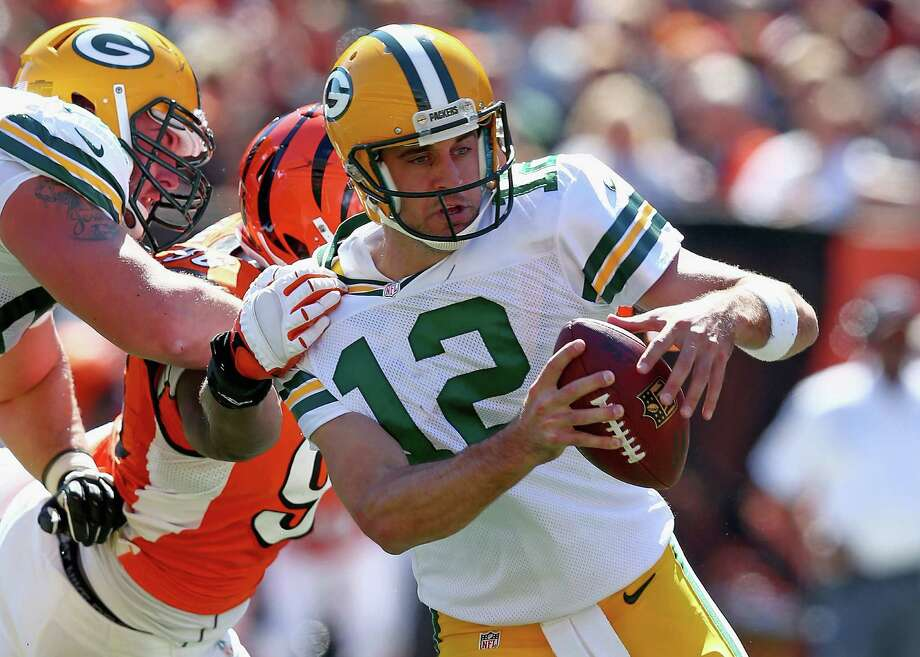 CINCINNATI, OH - SEPTEMBER 22:  Aaron Rodgers #12 of the Green Bay Packers runs with the ball during the NFL game against Cincinnati Bengals at Paul Brown Stadium on September 22, 2013 in Cincinnati, Ohio.  (Photo by Andy Lyons/Getty Images) ORG XMIT: 175878795 Photo: Andy Lyons / 2013 Getty Images