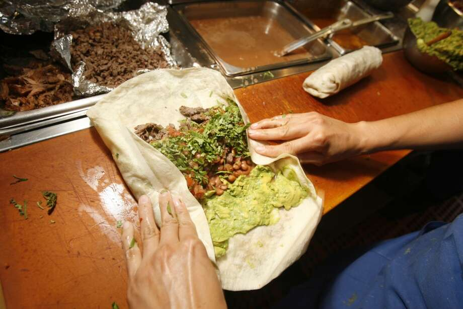 You heartily debate the neighborhood's best burrito. Photo: Eric Luse, San Francisco Chronicle