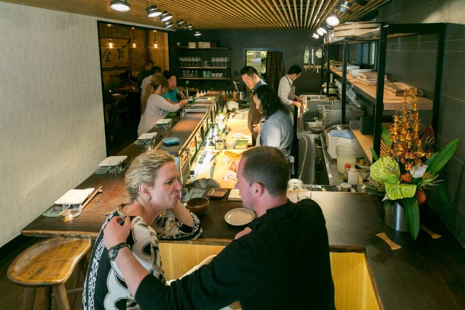 People have dinner at the sushi bar at Akiko's in San Francisco. Photo: John Storey, Special To The Chronicle