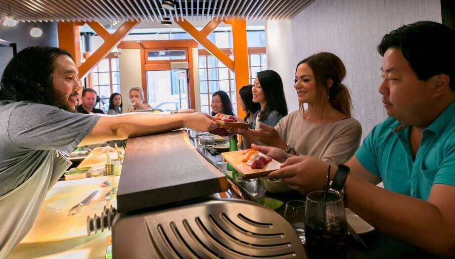 Chef Ricky Yap serves sushi to customers at Akiko's in San Francisco. Photo: John Storey, Special To The Chronicle