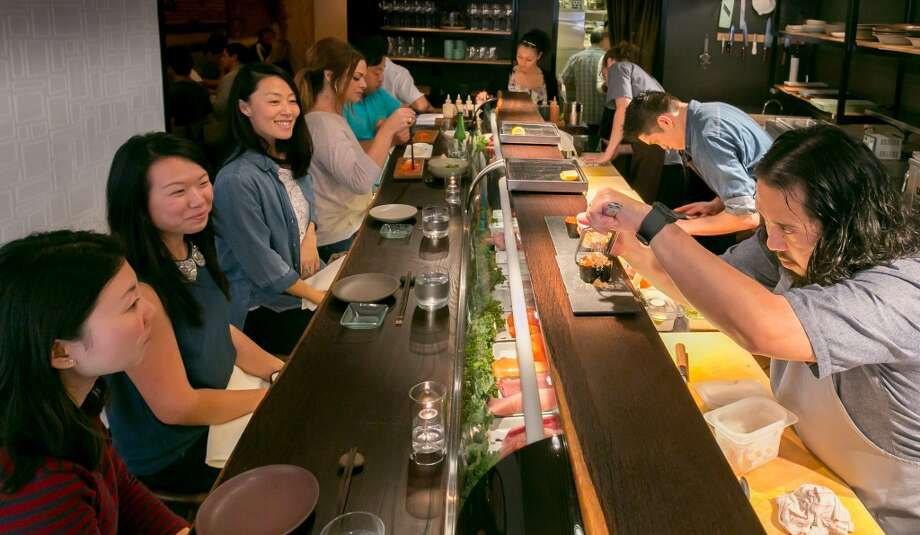Chef Ricky Yap prepares sushi for customers at Akiko's in San Francisco. Photo: John Storey, Special To The Chronicle