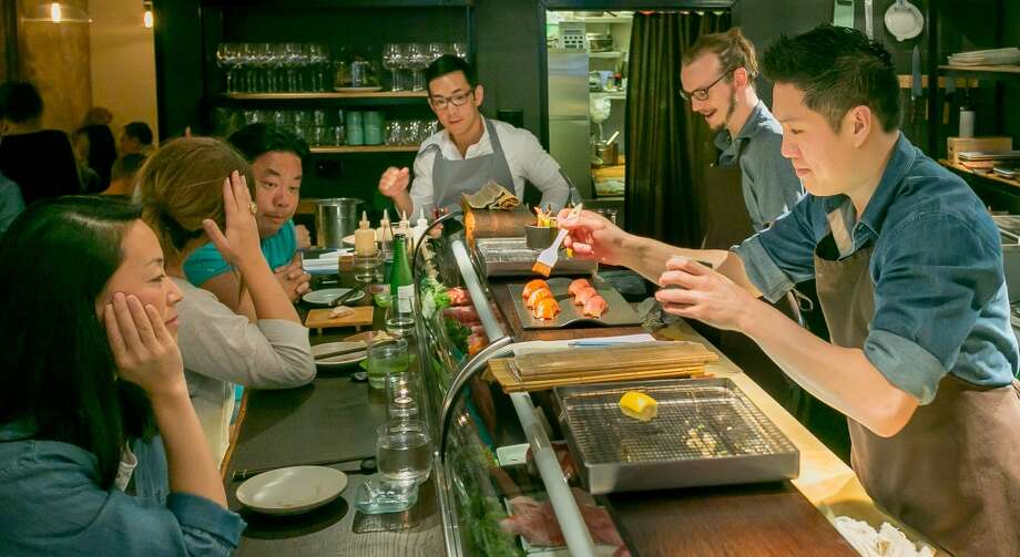 Geoffrey Lee prepares sushi for customers at Akiko's in San Francisco. Photo: John Storey, Special To The Chronicle