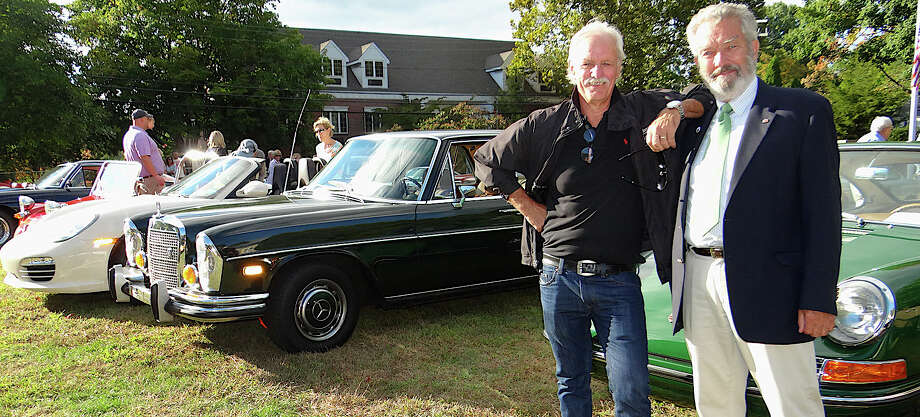 Concours d'Elegance co-founder Bill Scheffler and the Concours executive director Frank Taylor at the Classic Car Reception & Lawn Party on Veterans Green Sunday. Photo: Mike Lauterborn / Westport News contributed