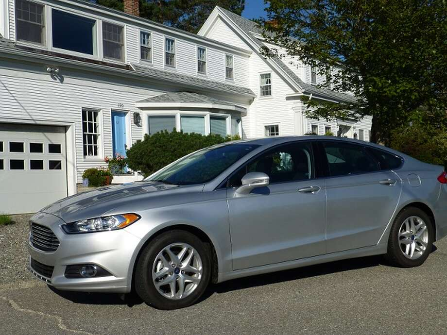 Another aspect of the Fusion, this time in front of a house on Naskeag Point, Brooklin, Maine. Note the Aston Martin-like grille on the Fusion.