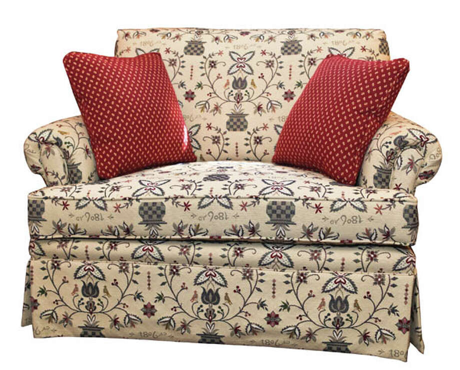 """Chair and a HalfOntario-style oversize chair by Hallagan, a family-owned upstate NewYork company that's been creating American-made pieces for over 100 years. 49""""x37""""x37"""", two pillows included. Price dependent on fabric; starts at $1,999. Available at Kugler's Red Barn."""