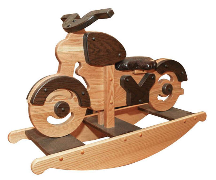 Vrrrooom!Children's rocking motorcycle is made in oak with a cushioned seat. $210. Available at Adirondack Wood Shed
