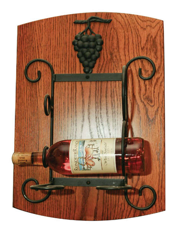 Wine RackWall hanging wooden wine rack, $60. Available at Adirondack Wood Shed.