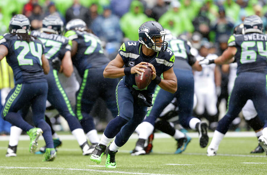Seattle Seahawks quarterback Russell Wilson looks to pass during play against the Jacksonville Jaguars in the first half of an NFL football game, Sunday, Sept. 22, 2013, in Seattle. Photo: Ted S. Warren, AP / AP