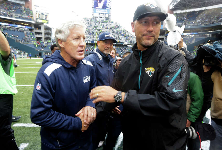 Seattle Seahawks head coach Pete Carroll, left, shakes hands with Jacksonville Jaguars head coach Gus Bradley, right, following an NFL football game on Sunday, Sept. 22, 2013, in Seattle. The Seahawks defeated the Jaguars 45-17. Bradley was the former defensive coordinator for the Seahawks. Photo: Ted S. Warren, AP / AP