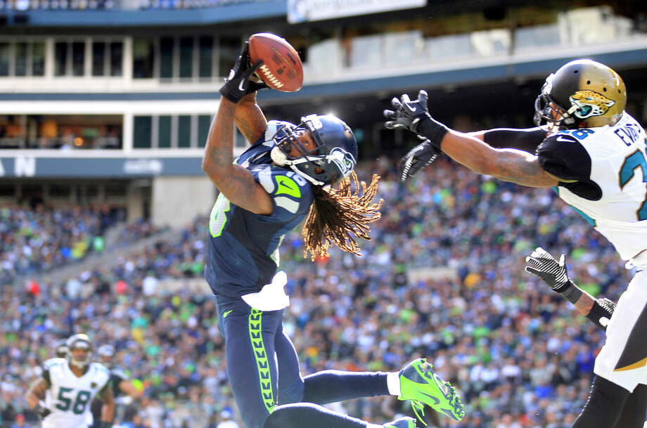 Seattle Seahawks' Sidney Rice, front left, snags the ball in the end zone for a touchdown in front of Jacksonville Jaguars' Josh Evans in the second half of an NFL football game on Sunday, Sept. 22, 2013, in Seattle. Photo: Stephen Brashear, ASSOCIATED PRESS / AP2013