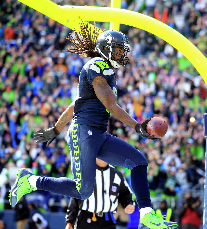 Seattle Seahawks' Sidney Rice celebrates after scoring against the Jacksonville Jaguars in the first half of an NFL football game on Sunday, Sept. 22, 2013, in Seattle. Photo: Stephen Brashear, AP / FR159797 AP