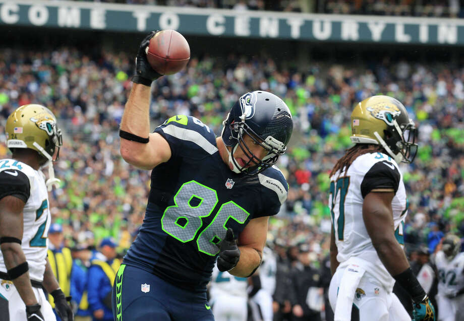 Seattle Seahawks' Zach Miller reacts after scoring his second touchdown reception against the Jacksonville Jaguars in the first half of an NFL football game on Sunday, Sept. 22, 2013, in Seattle. Photo: Stephen Brashear, ASSOCIATED PRESS / AP2013