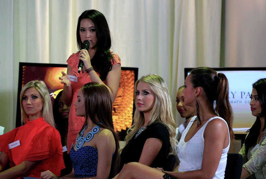 Miss Indonesia Vania Larissa speaks as other contestants, from left, Miss Belgium Noemie Happart, Miss Botswana Rosemary Keofitlhetse, Miss Brazil Sancler Frantz Konzen and Miss France Marine Lorphelin listen during a TV show beauty at Bali International Convention Center in Nusa Dua, Bali, Indonesia, Monday, Sept. 23, 2013. The Miss World pageant final will be held in Bali on Sept. 28. Photo: Firdia Lisnawati, AP / AP