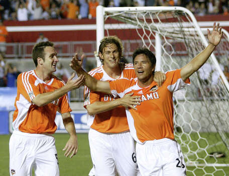 from left, Houston Dynamo's Ryan Cochrane and Kelly Gray celebrate a goal by Brian Ching, right, in the second half of play against the Kansas City Wizards on April 8, 2006 at Robertson Stadium in Houston. Ching's goal was not enough to win however and the Wizards claim a 2-1 victory over the Dynamo. Photo: Jessica Kourkounis, For The Chronicle / Freelance