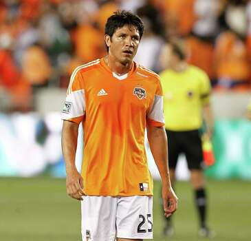Houston Dynamo forward Brian Ching #25 walks off the field as the final whistle blows as the Sporting KC defeats the Houston Dynamo 1-0 during a MLS soccer match between the Houston Dynamo and the Sporting KC, Sunday May 12, 2013.(Bob Levey/For The Chronicle) Photo: Bob Levey, For The Houston Chronicle / ©2013 Bob Levey