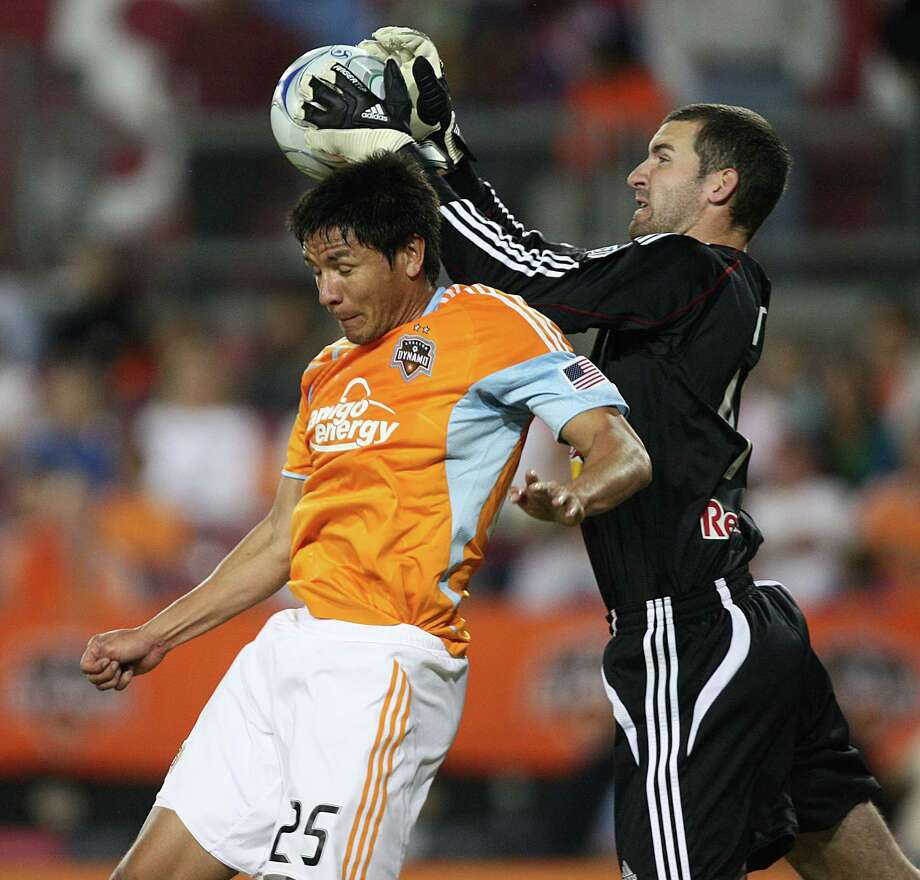 Houston's  Brian Ching  goes up for a header as New York goalkeeper   makes a save during the second half of a soccer game Saturday April 11, 2009 at Robertson Stadium in Houston,Tx. Houston  and New York played to a 0-0 tie. Photo: Bob Levey, For The Chronicle / Freelance