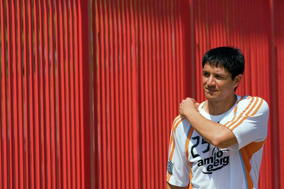 The Houston Dynamo's Brian Ching walks back to the locker room after pratice during the team's media day at the University of Houston's Robertson Stadium Thursday, March 19, 2009, in Houston.