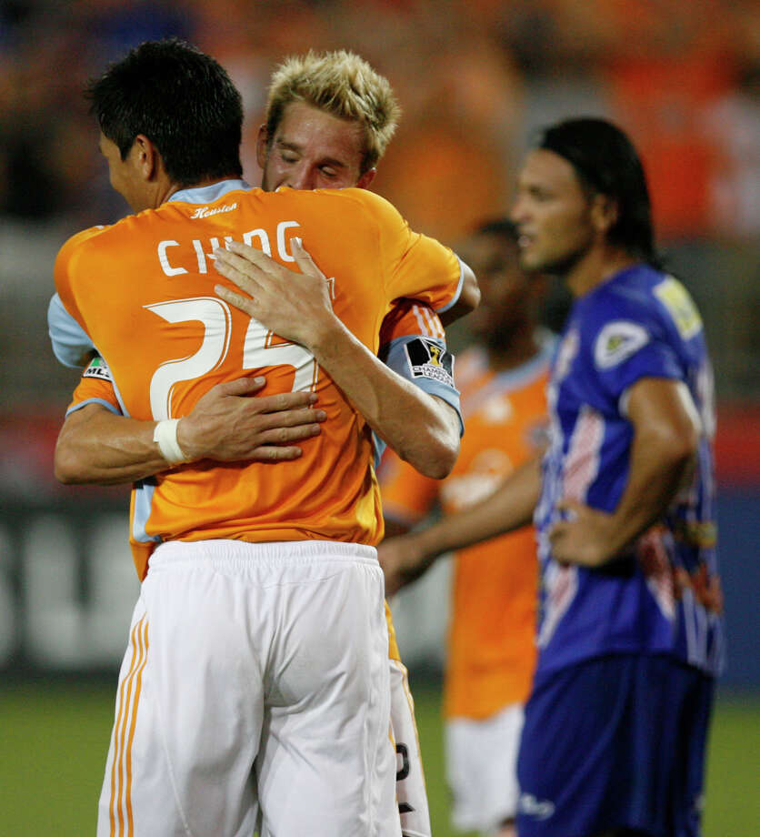 Houston Dynamo players Brian Ching (25) and Stuart Holden celebrate the lone goal of the match, which was scored by Brian Ching in the second half of a CONCACAF Champions League Tournament game between the Houston Dynamo and AD Isidro Metapan (El Salvador) at Robertson Stadium on Wednesday, Aug. 19, 2009, in Houston. ( Julio Cortez / Chronicle ) Photo: Julio Cortez, Houston Chronicle / Houston Chronicle