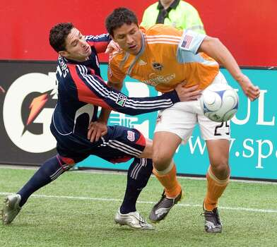 Houston Dynamo forward Brian Ching, right, attempts to get around the defense of New England Revolution defender Jay Heaps during the first half of an MLS soccer game at Gillette Stadium in Foxborough, Mass., Sunday, May 3, 2009. Photo: Stew Milne, AP / FR56276 AP