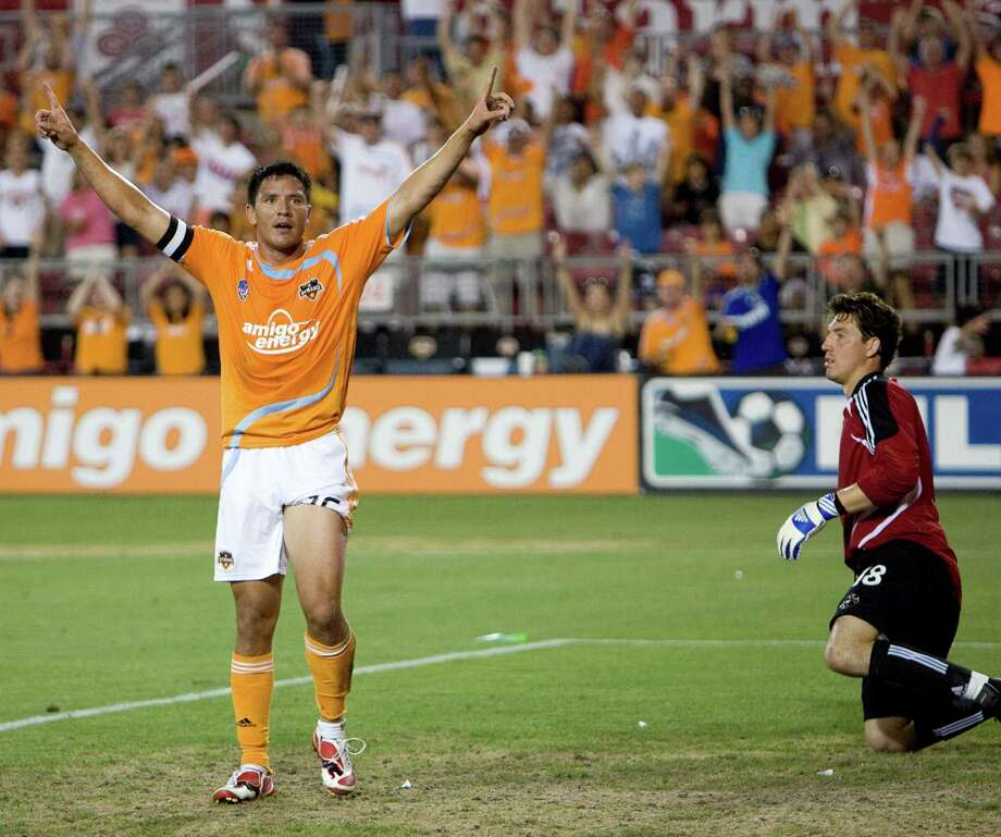 Houston Dynamo forward Brian Ching celebrates his second half goal as he beats Red Bull goalkeeper Jon Conway as the Dynamo defeated the Red Bull 1-0 May 31, 2008 in Houston, Texas. Photo: Bob Levey, For The Chronicle / Freelance