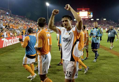 Houston Dynamo's Brian Ching (25) celebrates after the Dynamo defeated FC Dallas in MLS soccer playoff action at Robertson Stadium, Friday, Nov. 2, 2007, in Houston. ( Smiley N. Pool / Chronicle ) Photo: Smiley N. Pool, Houston Chronicle / Houston Chronicle
