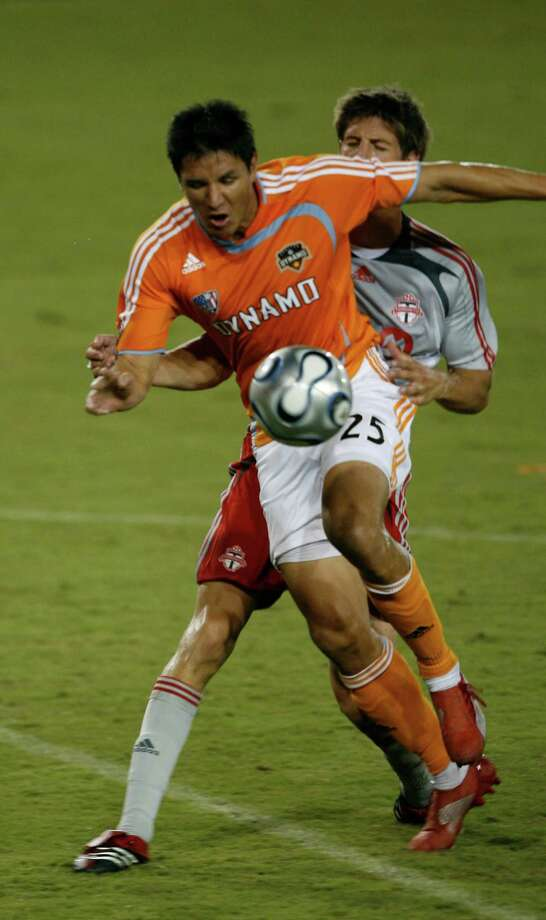 Houston Dynamo forward Brian Ching fights Toronto FC defender Andrew Boyens for the ball in the second half Sunday, July 15, 2007, at Robertston Stadium in Houston. The game ended in a tie. This photo accompanies a Bernardo Fallas sports story.  ( Kevin Fujii / Chronicle ) Photo: Kevin Fujii, Houston Chronicle / Houston Chronicle