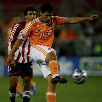Houston forward  Brian Ching puts a hard shot on goal late in the first half as the Dynamo, 0-0-1 on the season, play Chivas USA in Robertson Stadium at the University of Houston Saturday evening April 14, 2007.
