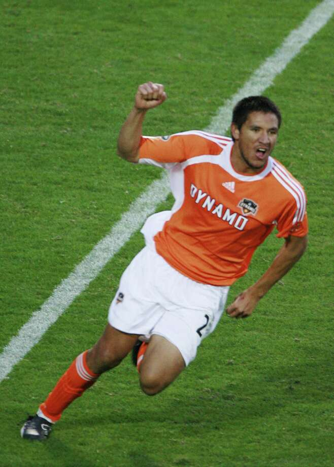 The Houston Dynamo's Brian Ching pumps his fist in the air after scoring a gaol against the New England Revolution's during the second half of overtime of the MLS Cup 2006 at Pizza Hut Park in Frisco, Texas November 12,2006.  