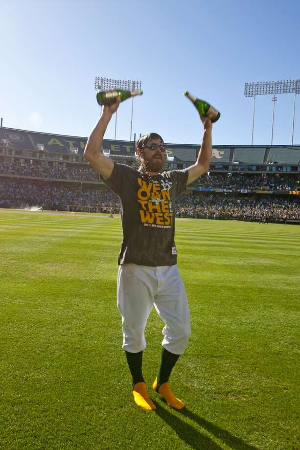 Josh Reddick #16 of the Oakland Athletics celebrates in the outfield after the game against the Minnesota Twins at O.co Coliseum on September 22, 2013 in Oakland, California. The Oakland Athletics defeated the Minnesota Twins 11-7 as they clinched the American League West Division. Photo: Jason O. Watson, Getty Images