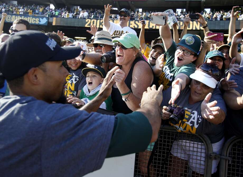 Coco Crisp got the fans excited as he shook hands around the stadium after the win. The Oakland A's defeated the Twins 11-7 and captured the American League Western division championship Sunday September 22, 2013 at O.co coliseum in Oakland, Calif. Photo: Brant Ward, The Chronicle
