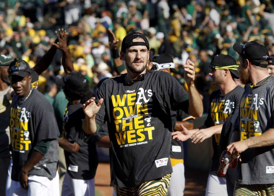 Relief pitcher Dan Otero joined other A's thanking fans after the victory. The Oakland A's defeated the Twins 11-7 and captured the American League Western division championship Sunday September 22, 2013 at O.co coliseum in Oakland, Calif. Photo: Brant Ward, The Chronicle