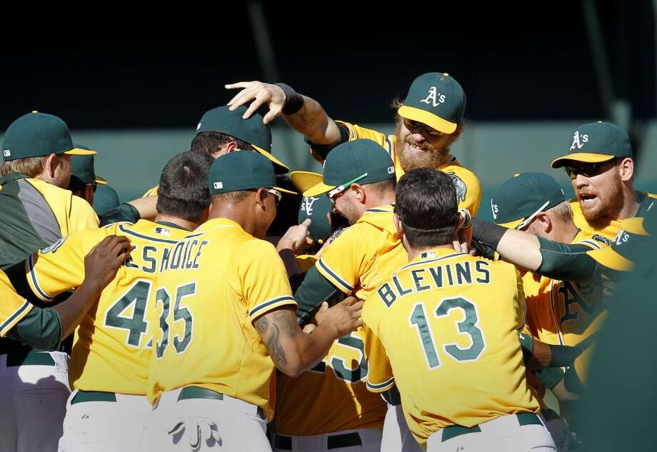 A's players mobbed the pitching mound and pitcher Evan Scribner after the win. The Oakland A's defeated the Twins 11-7 and captured the American League Western division championship Sunday September 22, 2013 at O.co coliseum in Oakland, Calif. Photo: Brant Ward, The Chronicle