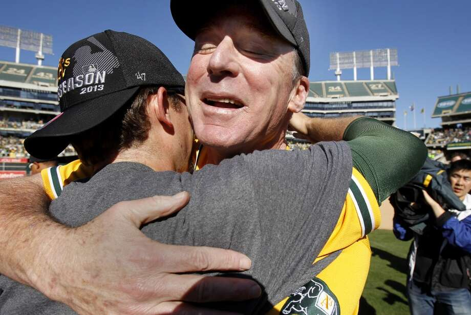 A's Manager Bob Melvin got a hug from an unidentified player after the victory. The Oakland A's defeated the Twins 11-7 and captured the American League Western division championship Sunday September 22, 2013 at O.co coliseum in Oakland, Calif. Photo: Brant Ward, The Chronicle
