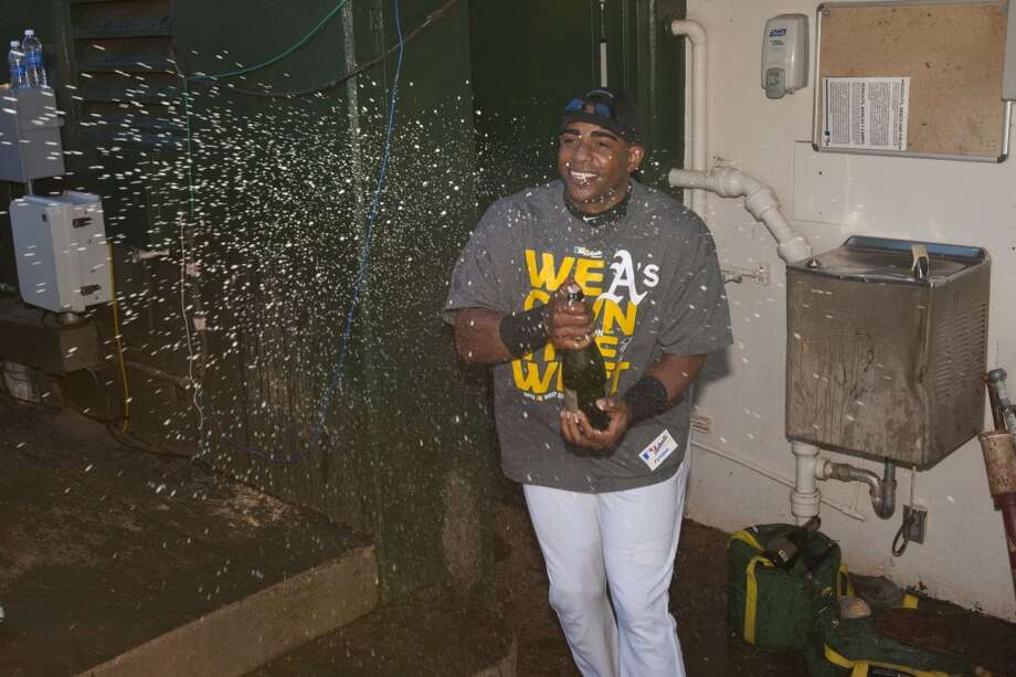 Yoenis Cespedes celebrates in the dugout after the game against the Minnesota Twins. Photo: Jason O. Watson, Getty Images