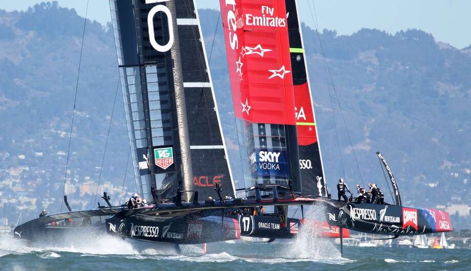 Oracle Team USA and Emirates Team New Zealand race side by side during the America's Cup sailing event in San Francisco on Sunday, Sept. 22, 2013. Oracle Team USA won both races to make the finals 8-5 in favor of New Zealand. Photo: Mathew Sumner, Special To The Chronicle