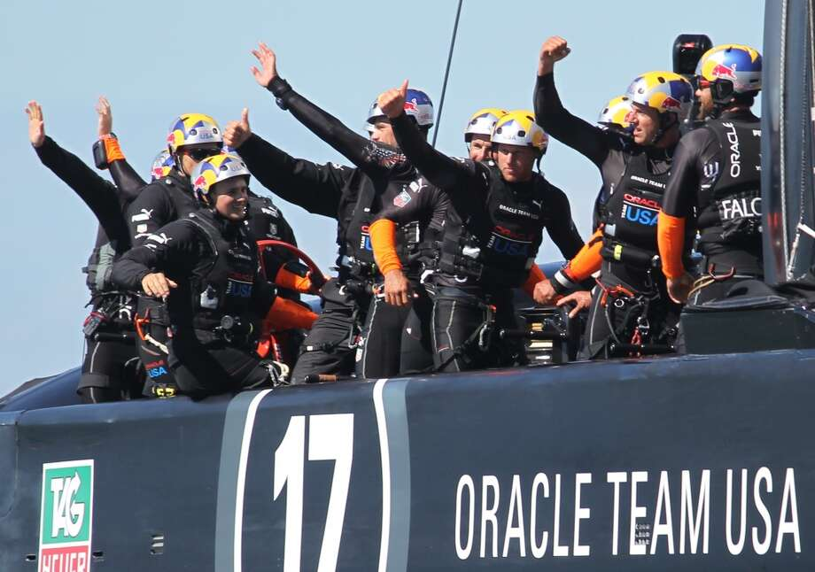 Oracle Team USA waves to fans after winning two races against Emirates Team New Zealand during the America's Cup sailing event in San Francisco on Sunday, Sept. 22, 2013. Photo: Mathew Sumner, Special To The Chronicle