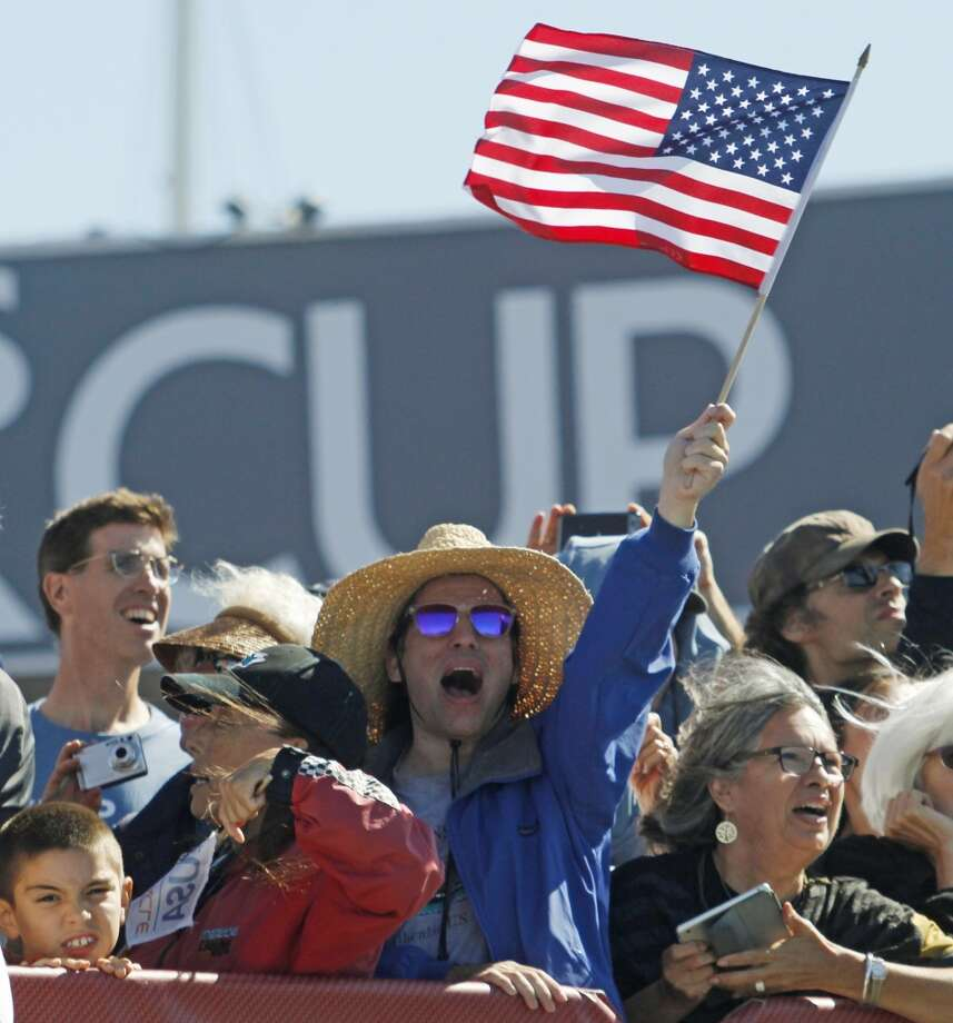 A fan celebrates after Oracle Team USA beat Emirates Team New Zealand in the 14th and 15th races of the America's Cup sailing event, Sunday, Sept. 22, 2013, in San Francisco. Photo: George Nikitin, Associated Press
