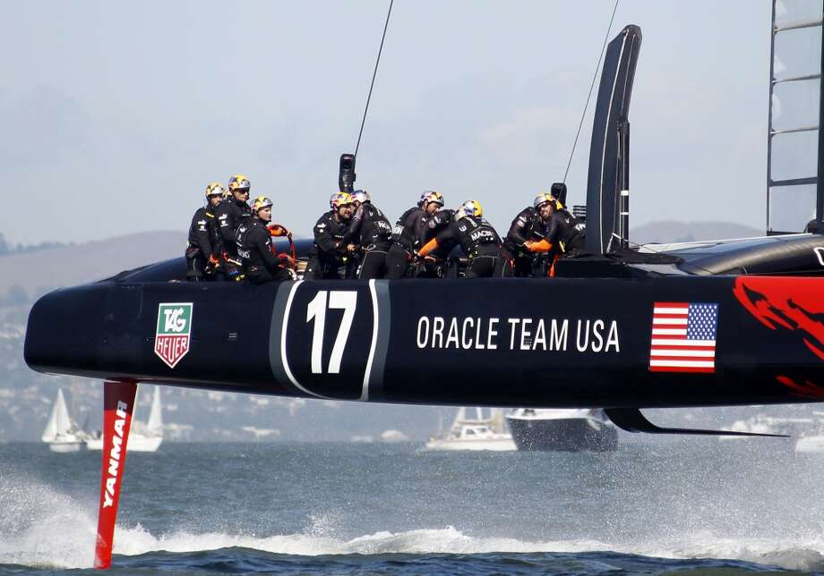 Oracle Team USA competes during the 15th race of the America's Cup sailing event against Emirates Team New Zealand, Sunday, Sept. 22, 2013, in San Francisco. Oracle Team USA won the 14 and 15th races on Sunday. Photo: George Nikitin, Associated Press